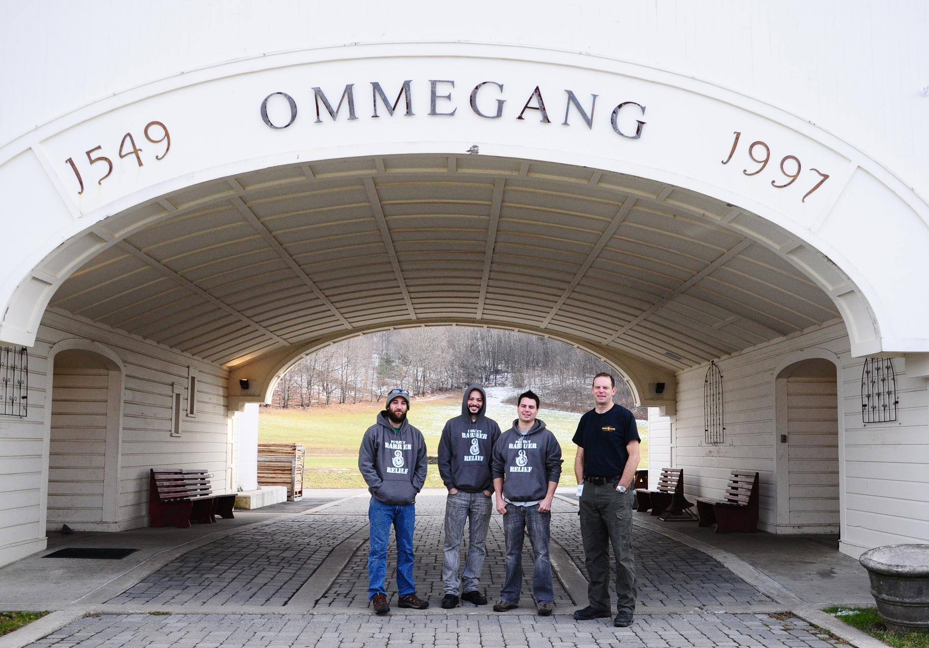 "Barrier Brewing Company's Evan Klein, Sean Redmond, and Craig Frymark with Brewery Ommegang's Brewmaster Phil Leinhart, modeling ""Project Barrier Relief"" shirts at Brewery Ommegang."