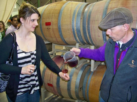 Bob Madill pouring barrel samples for a customer at Sheldrake Point
