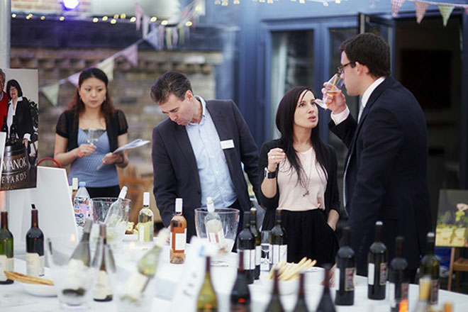 Member of the trade taste New York wines in the United Kingdom.