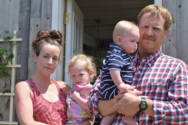 VERA CHINESE PHOTO Carey and Regan Meador outside thier Southold tasting barn with their children Coralai and Sawyer.